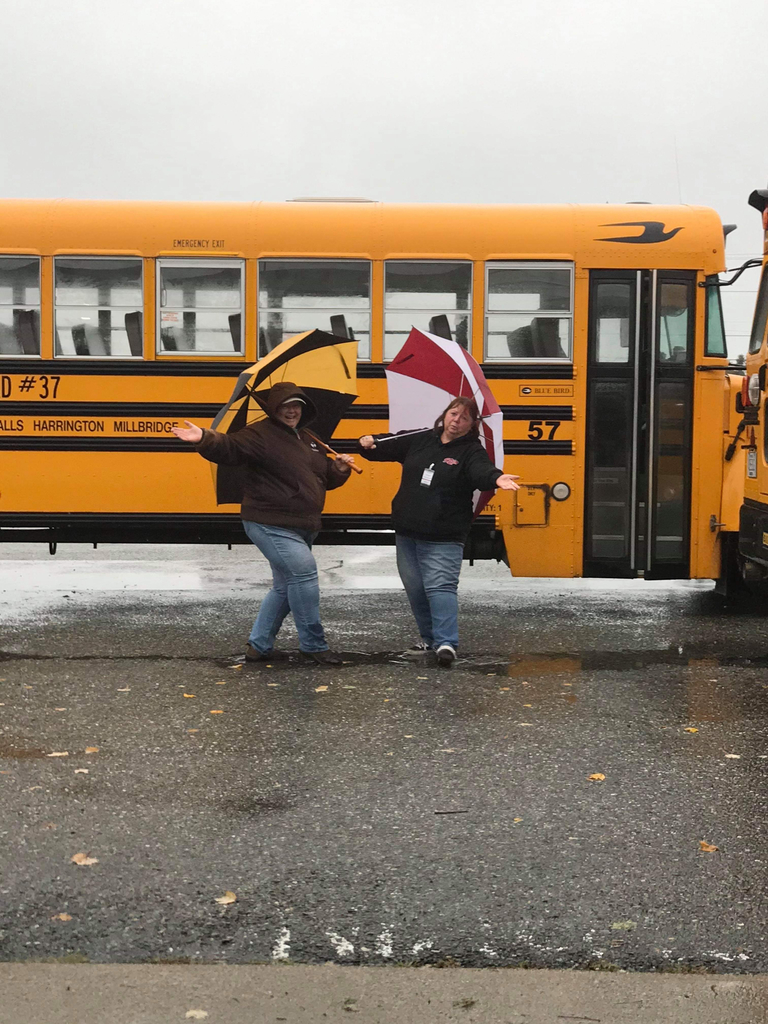 Two of wonderful bus drivers braving the elements to teach our 7th and 8th graders bus evacuation safety.